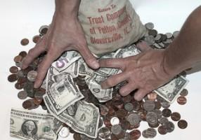 wealth greed thumb